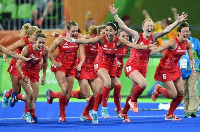 Britain's players celebrate their victory at the end of the women's Gold medal hockey Netherlands vs Britain match of the Rio 2016 Olympics Games at the Olympic Hockey Centre in Rio de Janeiro on August 19, 2016. / AFP PHOTO / MANAN VATSYAYANAMANAN VATSYAYANA/AFP/Getty Images